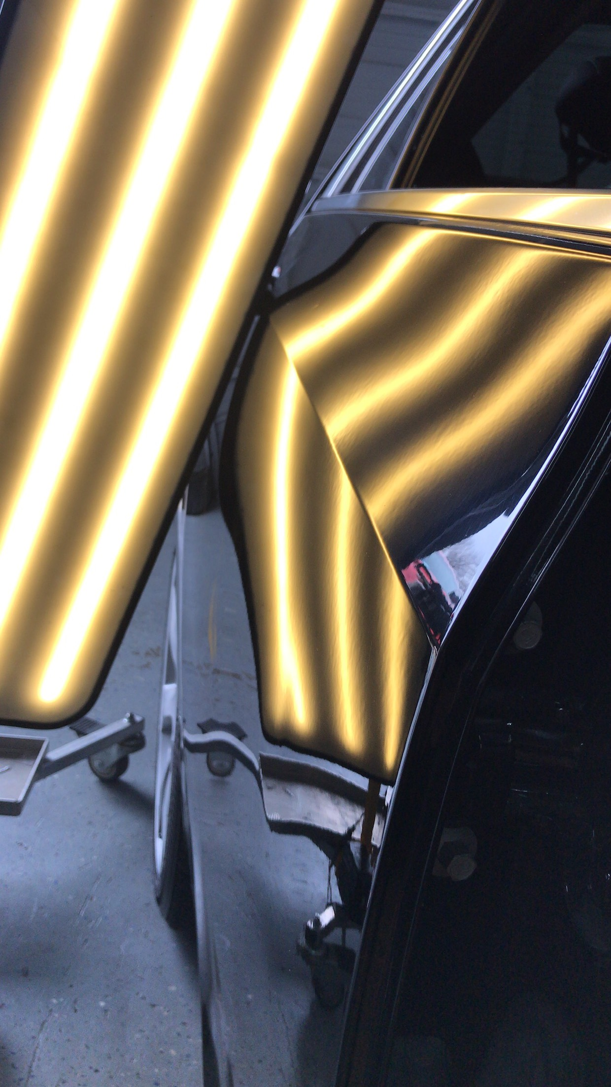 sedan car after hail dent repair