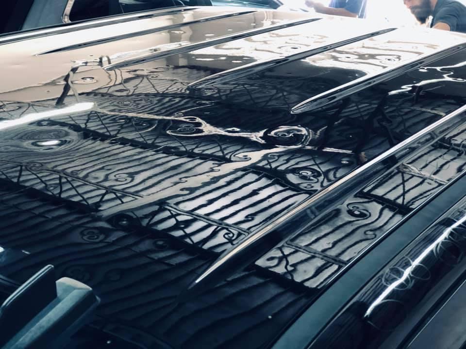 black car before hail dent repair