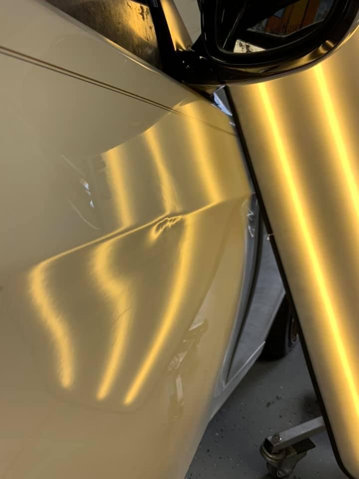 white car door dent