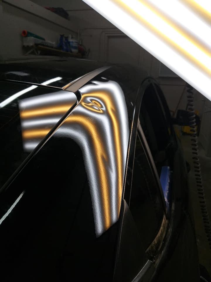 black car hood dent