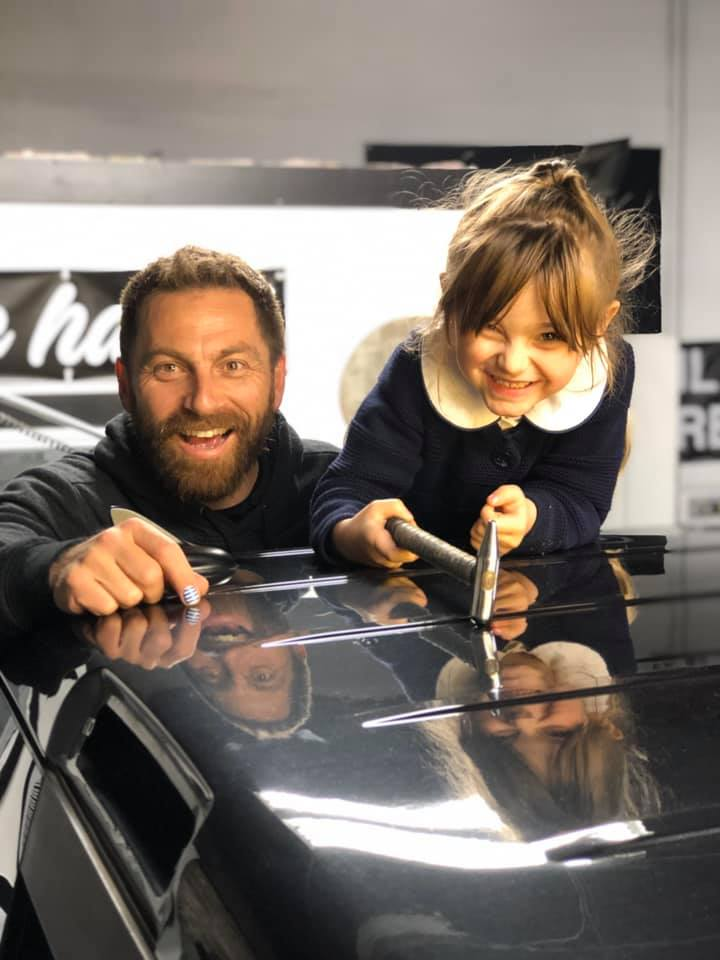 father and daughter in a car