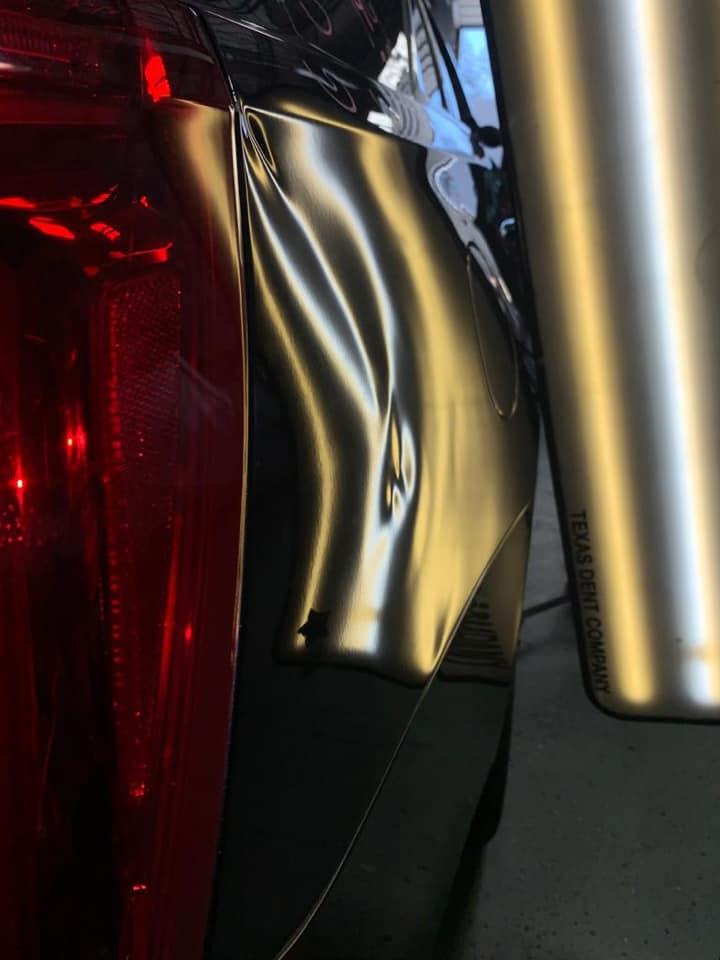 car dent near gas tank
