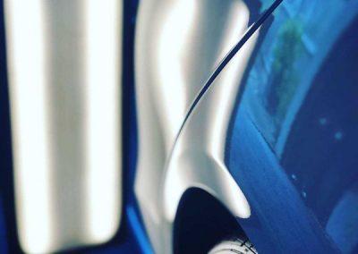 blue car dent repair
