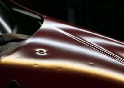 red car hood dent